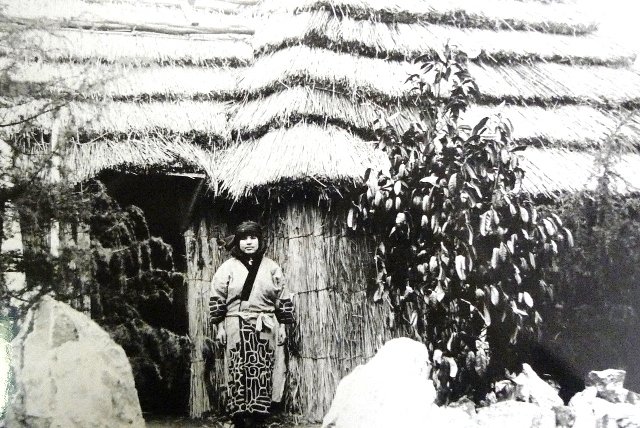 Japanese villager outside a traditional house